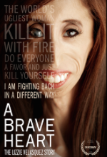 A Brave Heart movie poster. A young woman with a gaunt face, long brown hair, and one cloudy eye smiles at the camera. Text is super imposed over half of her face.